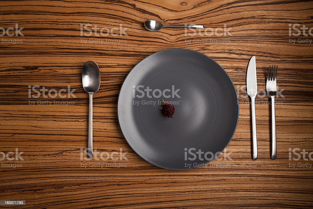 Table setup with a peach pip instead of food royalty-free stock photo