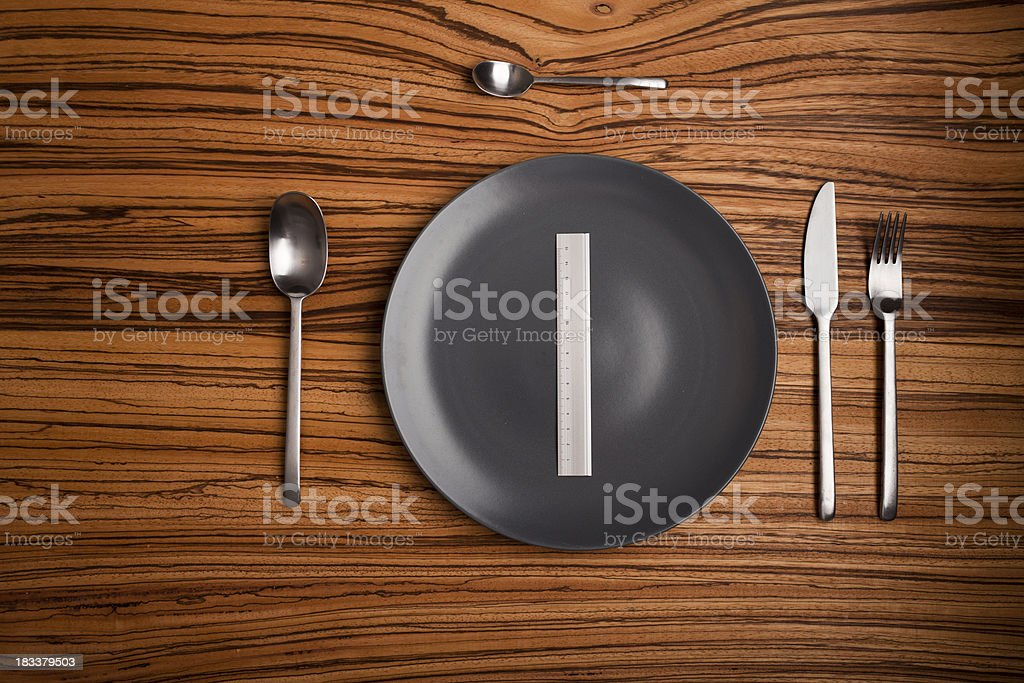 Table setup with a ruler instead of food royalty-free stock photo