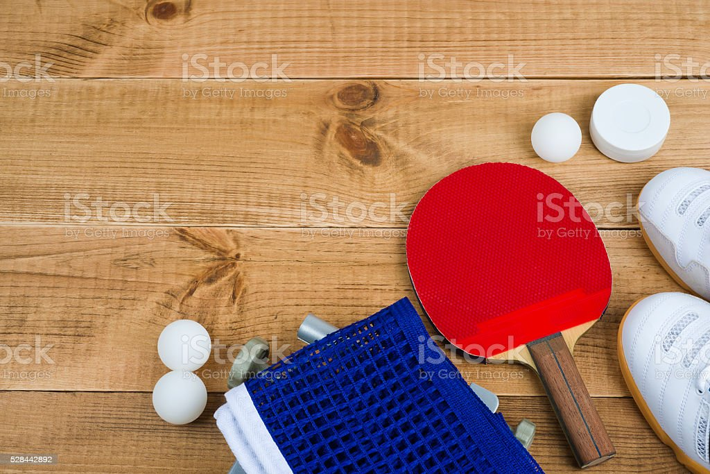 Table tennis equipment on wooden texture background with copy space stock photo