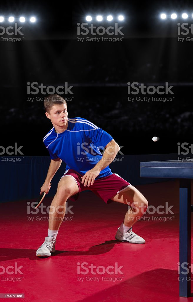 Table tennis player at sports hall stock photo