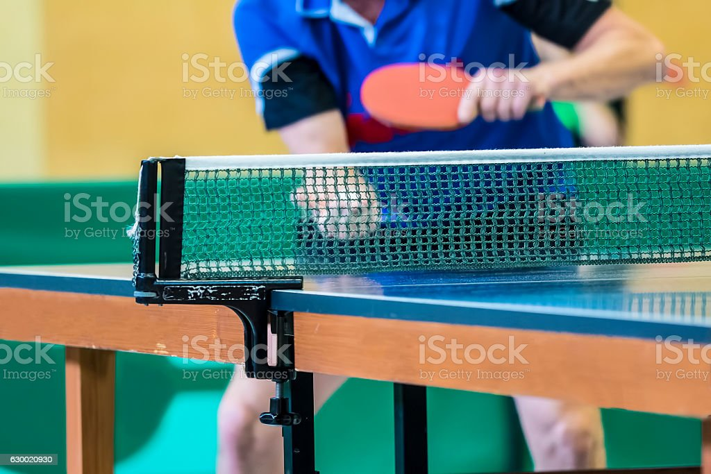 table tennis player serving stock photo