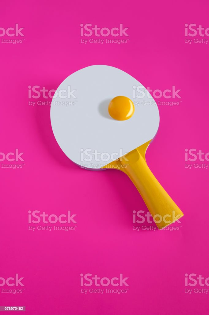 table tennis racket and egg yolk symboling tennis ball