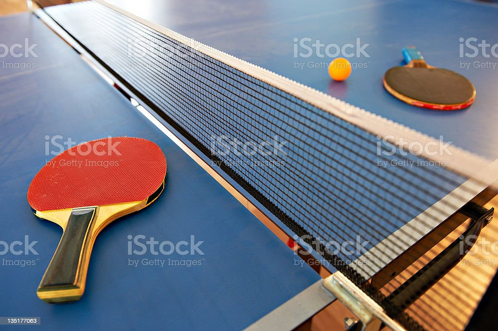 Table tennis rackets and orange ball royalty-free stock photo