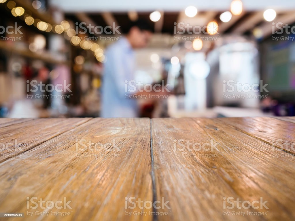 Table Top counter Bar with Blurred Barista in restaurant cafe stock photo