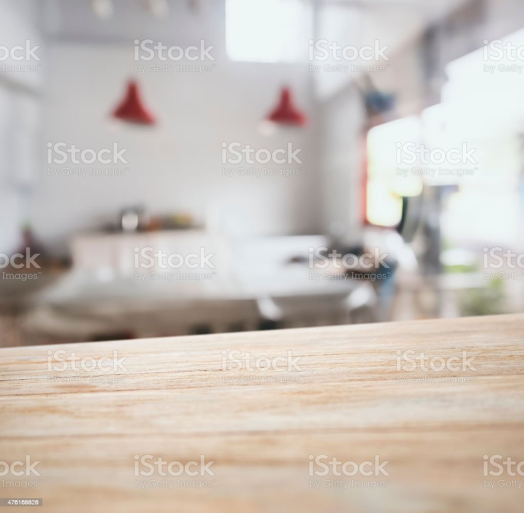 Table top counter bar with blurred kitchen background stock photo
