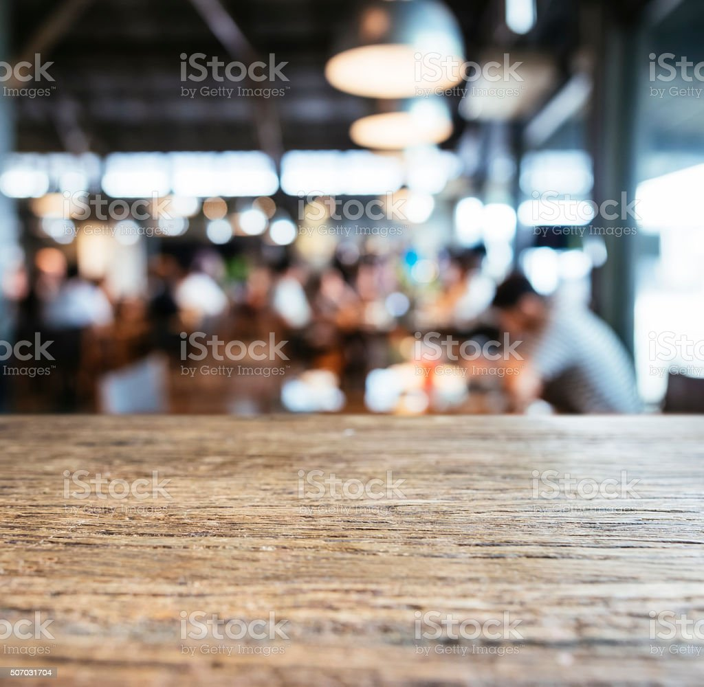 Table top counter Bar with Blurred people in Restaurant Cafe stock photo