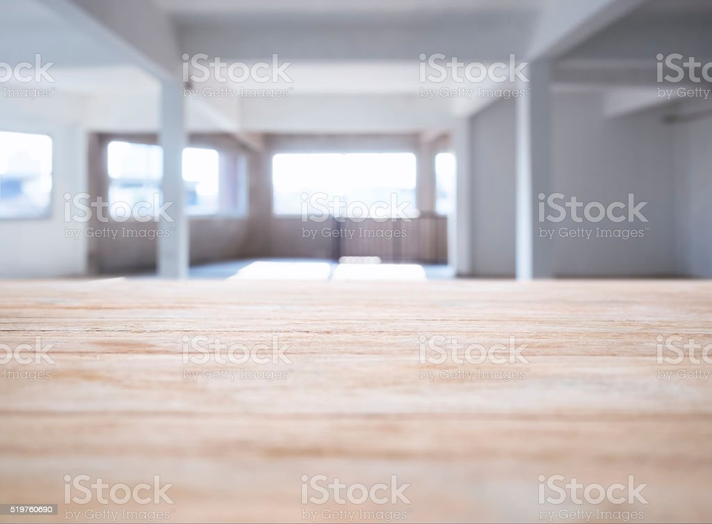 Table top counter bar with Interior Loft space background stock photo