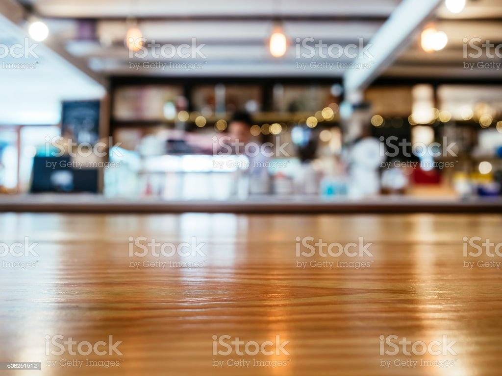 Table top Counter Blurred Bar Restaurant with Barista stock photo