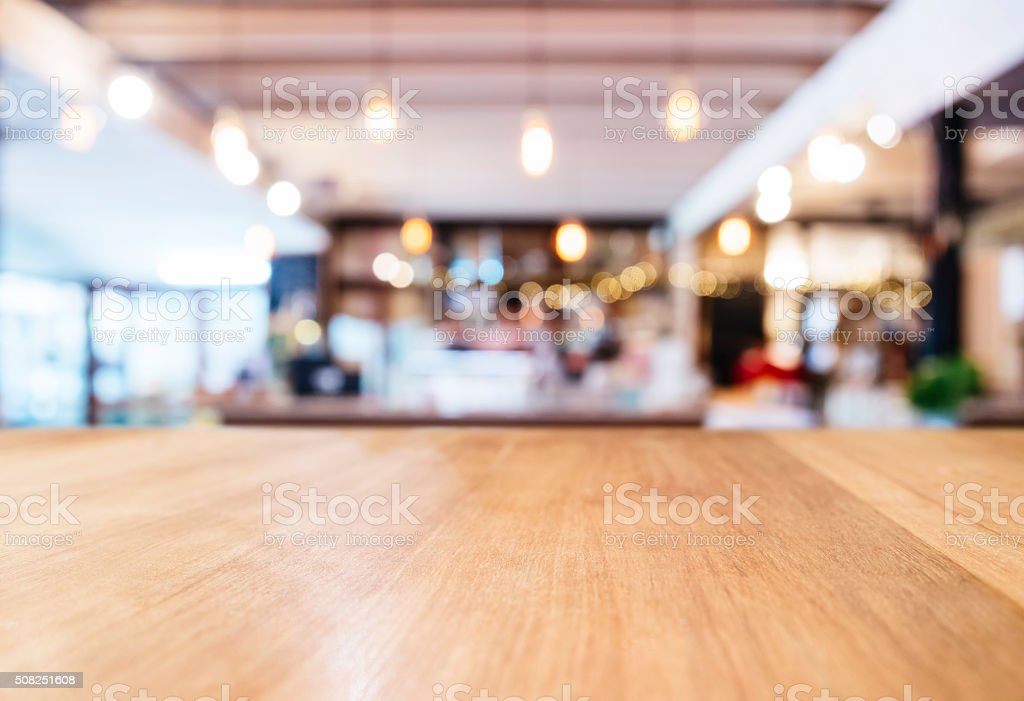 Table top Counter with Blurred Bar Restaurant backgroud stock photo