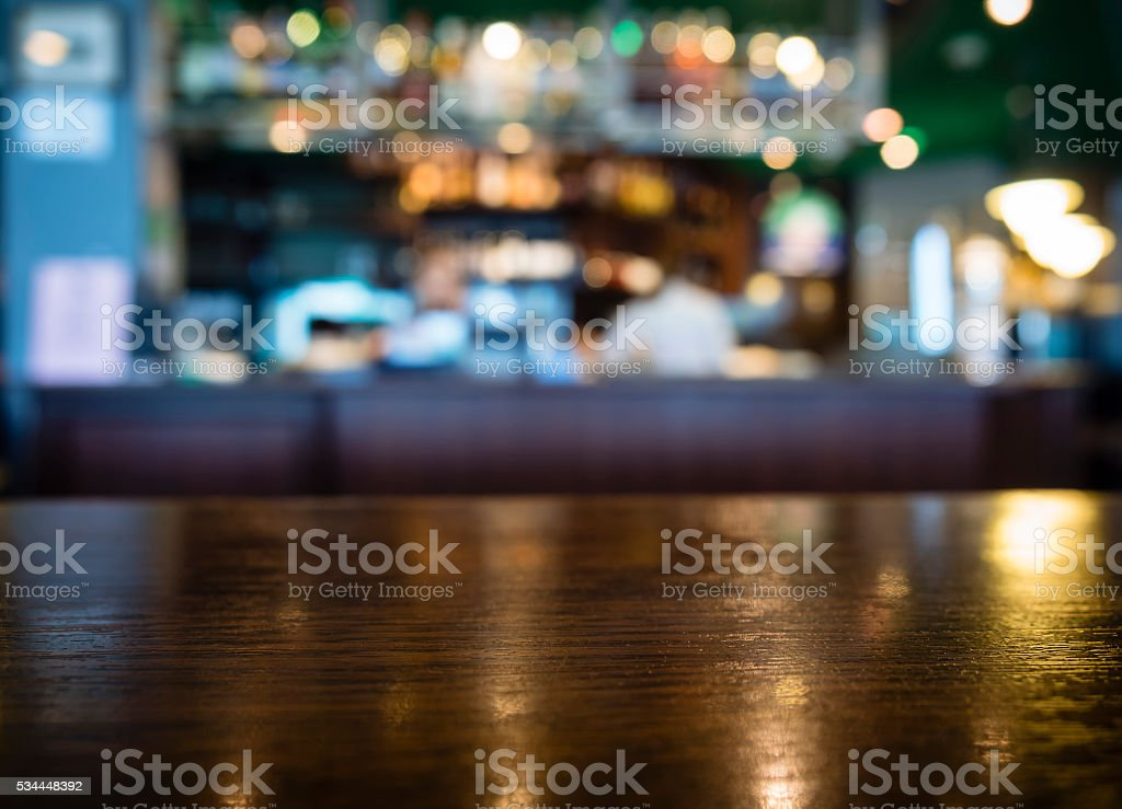 Table top Counter with Blurred Bar Restaurant Background stock photo