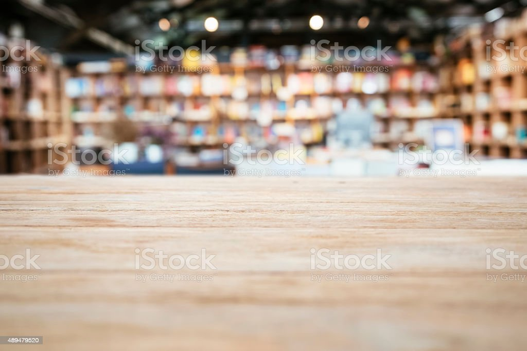 Table top Counter with Blurred Bookshelf Bookstore Background stock photo