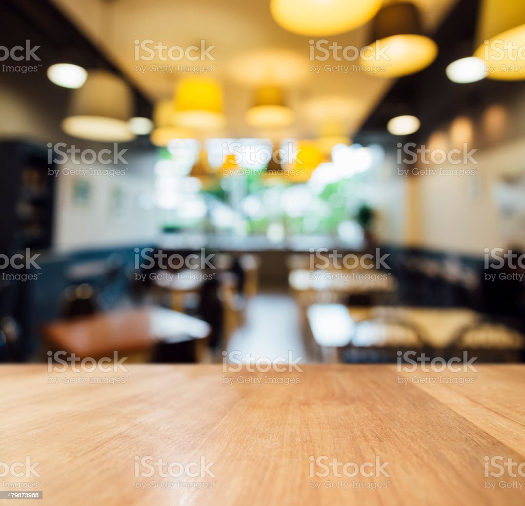 Table top counter with Blurred cafe Restaurant Lighting decoration stock photo