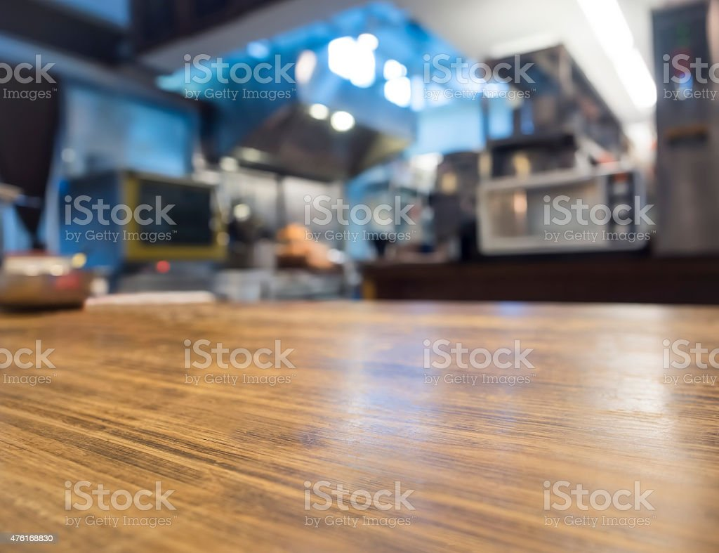 Table top counter with Blurred Kitchen Interior Background stock photo