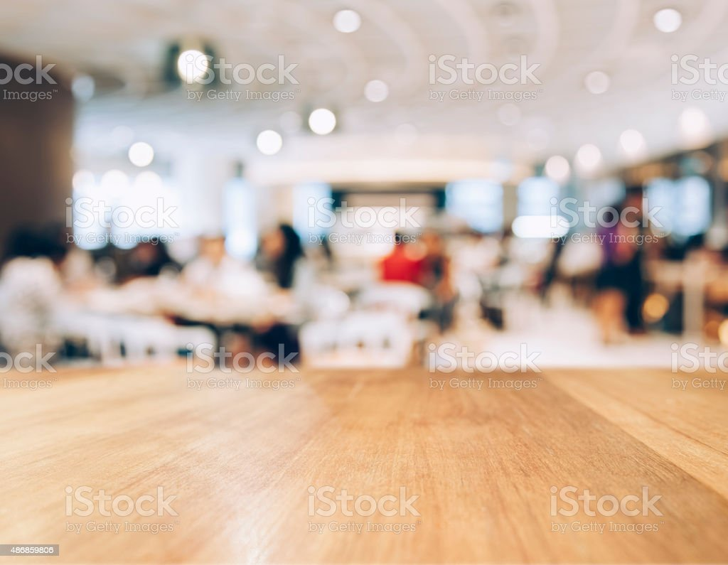Table top Counter with Blurred People in Restaurant Shop stock photo