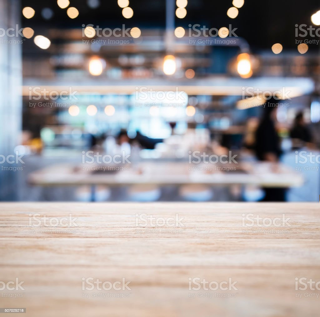 Table top Counter with Blurred People Restaurant Shop interior stock photo