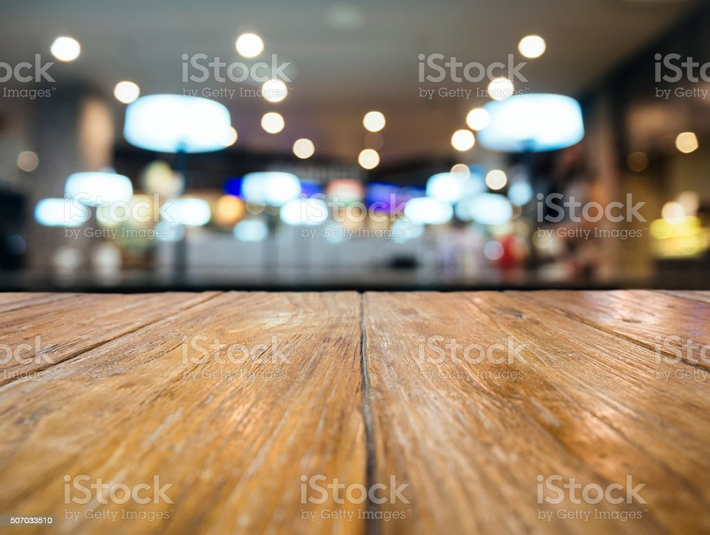 Table top Counter with Blurred Restaurant Shop interior stock photo