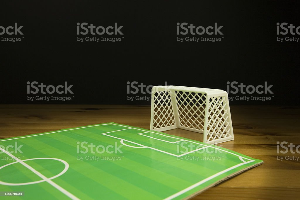 Table Top FootBall Pitch and A white Plastic Goal stock photo