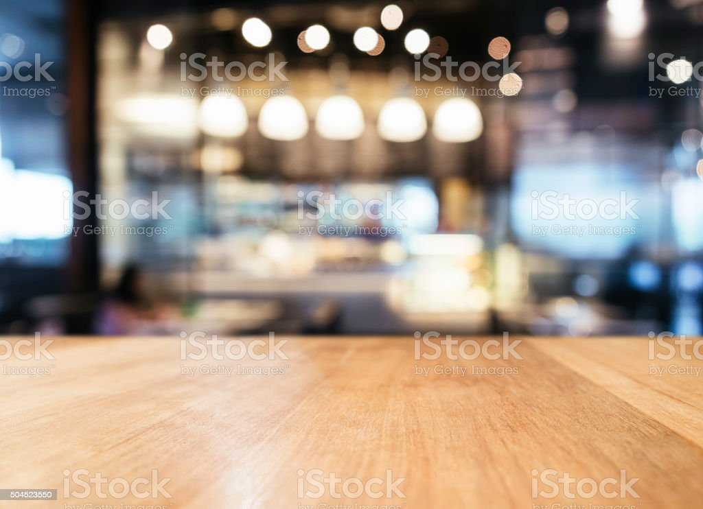 Table top with Blurred Bar restaurant cafe interior background stock photo