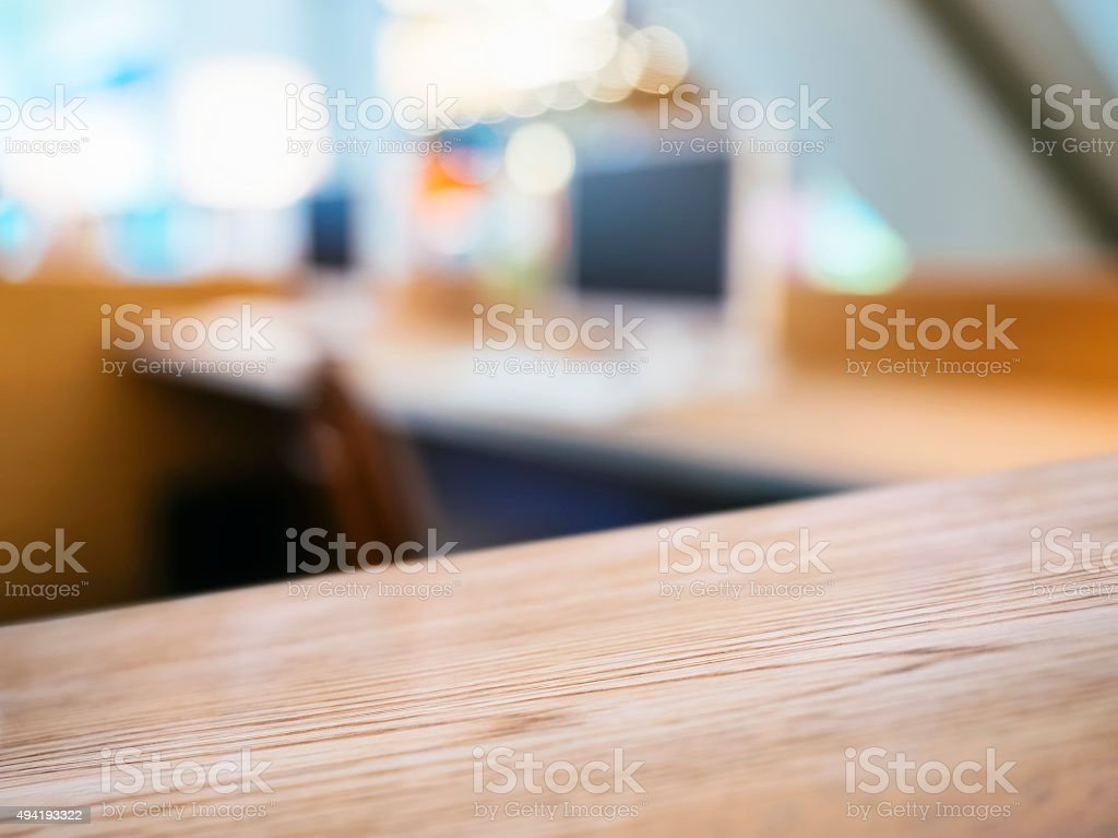 Table top with Blurred Computer Office desk background stock photo