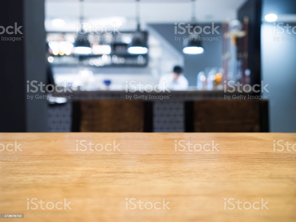 Table top with Blurred kitchen and chef on background stock photo