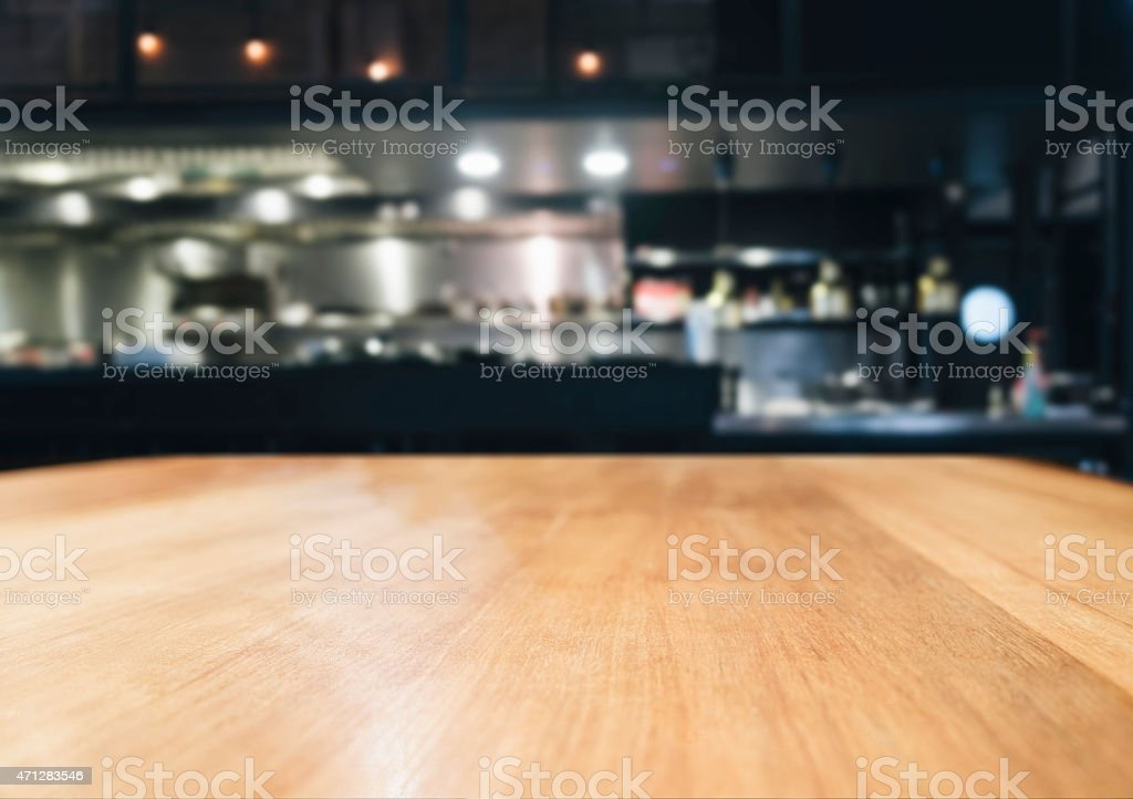 Table top with blurred kitchen background stock photo
