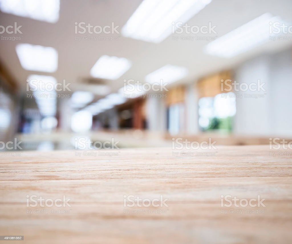 Table top with Blurred Office space Interior stock photo