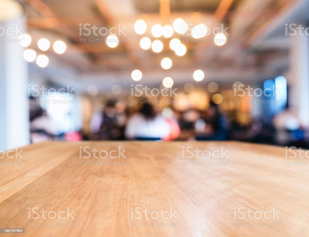 Table top with Blurred People Cafe Shop interior background stock photo