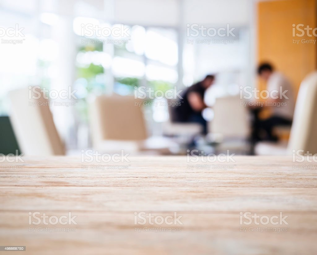 Table Top with Blurred People Interior Lobby stock photo