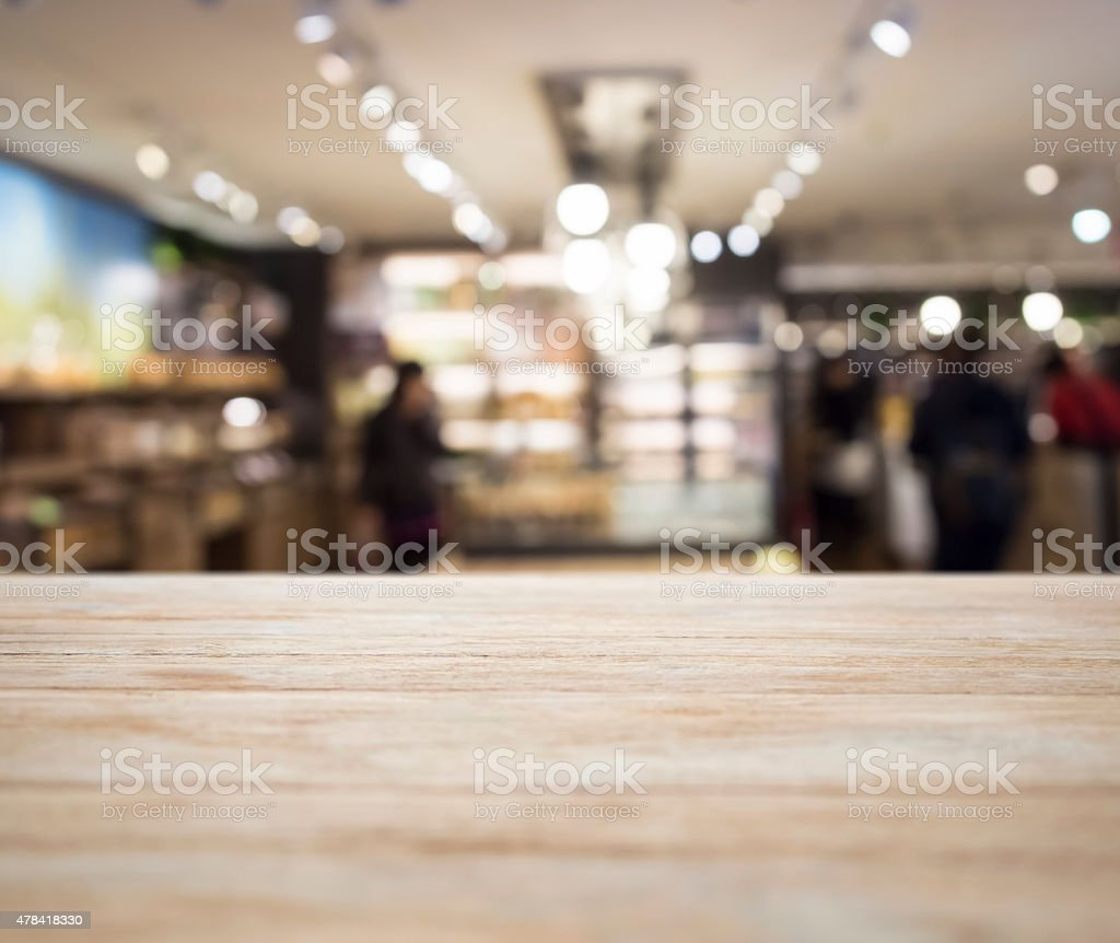 Table top with Blurred Retail shop Interior decoration stock photo