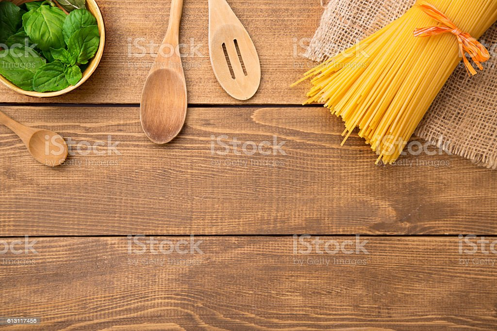 Table top with pasta and basil stock photo