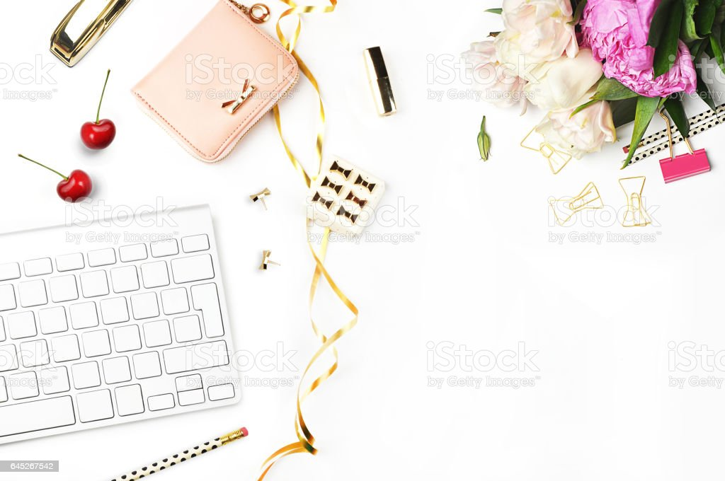 Table view office items, white background mock-up, woman desk. Office desktop,gold items. Flat lay. Invitation template, gold polka. stock photo