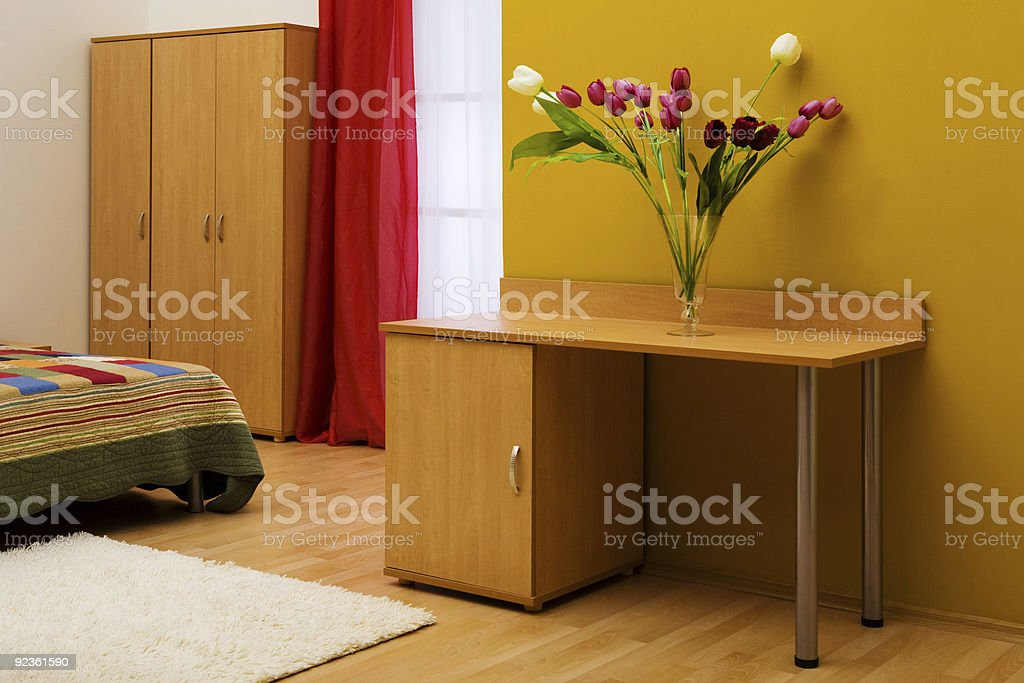 Table with a bouquet of tulips royalty-free stock photo