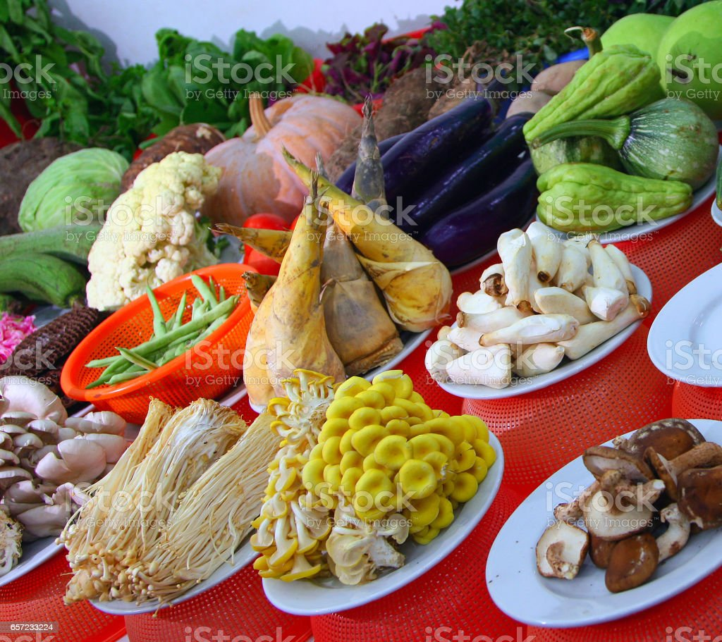 table with a variety of fresh vegetables and mushrooms stock photo