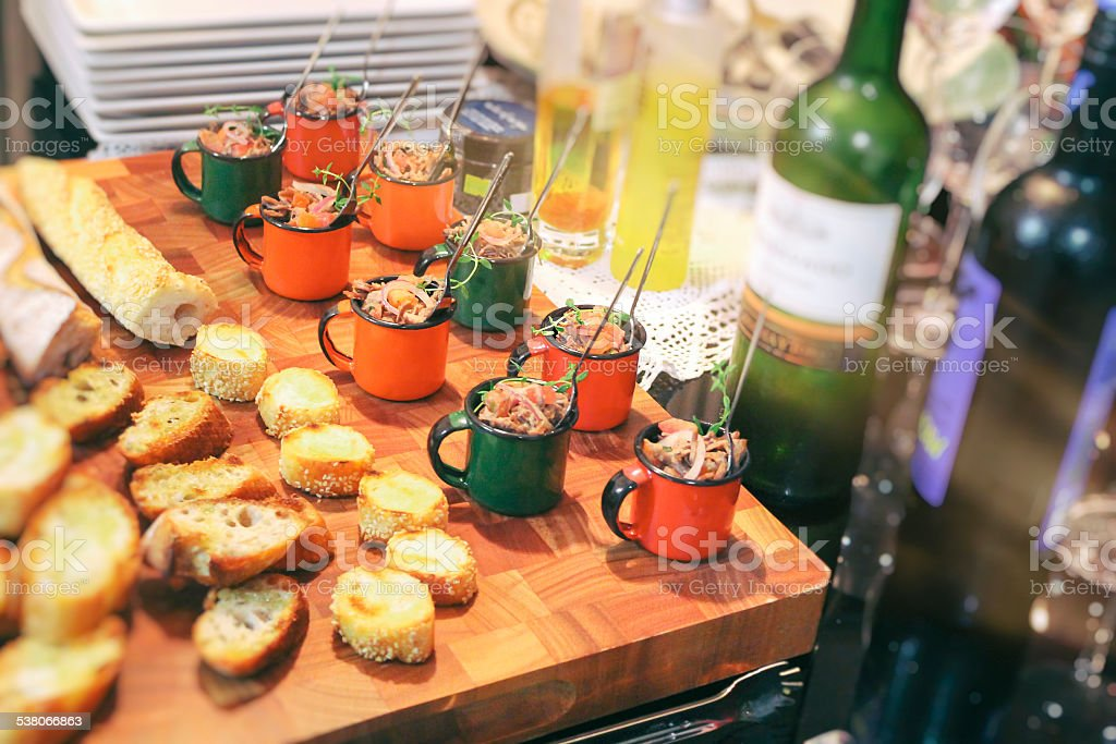 Table with appetizers and wine. stock photo