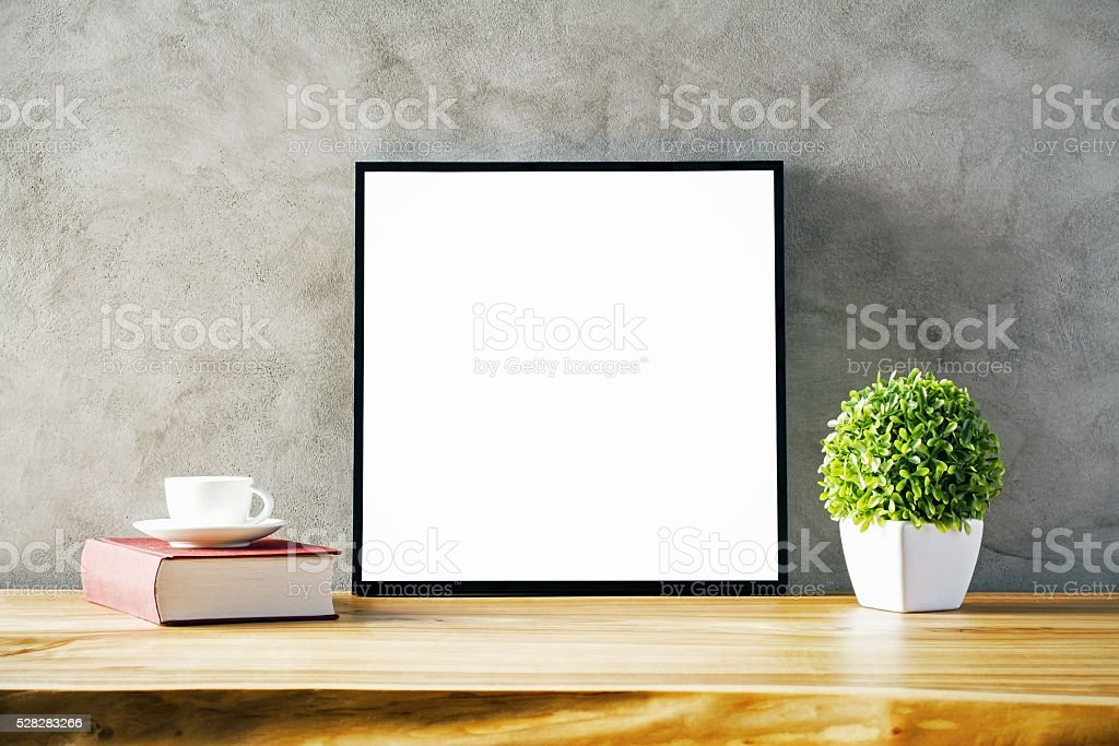 Table with blank frame stock photo