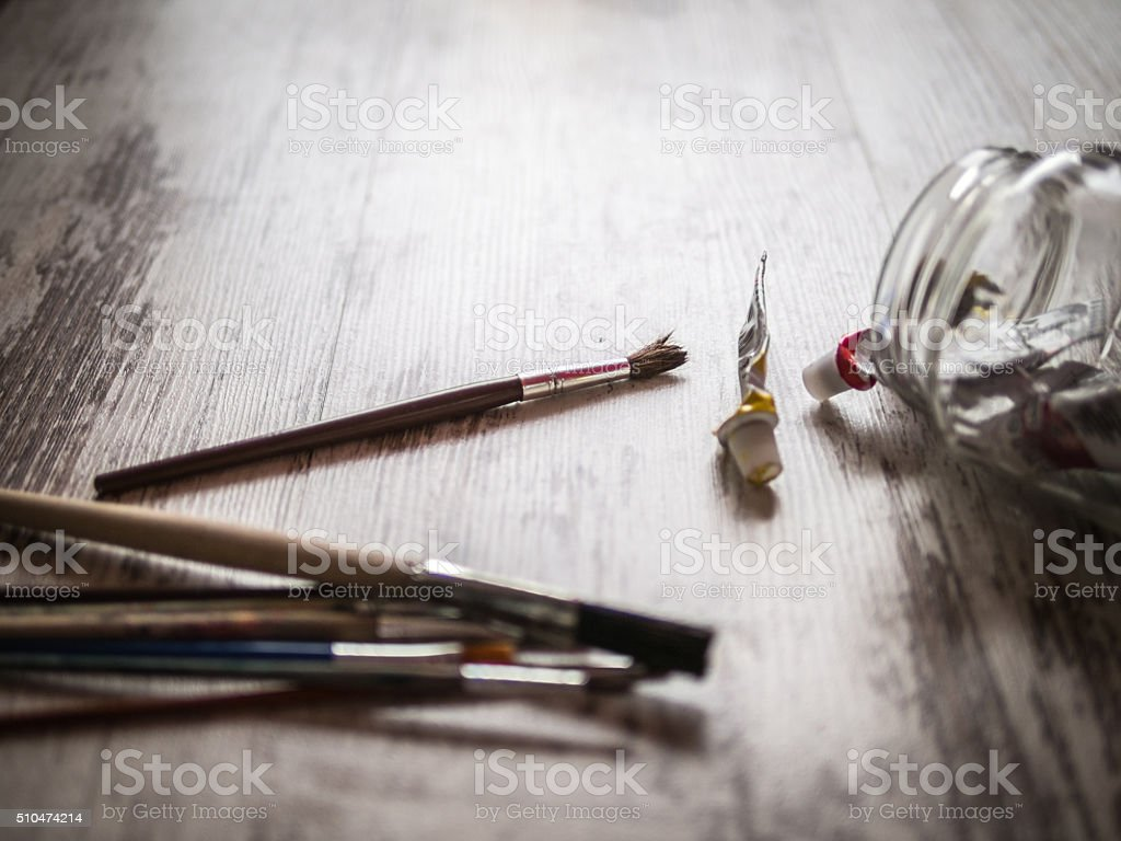 table with brushes and paints stock photo