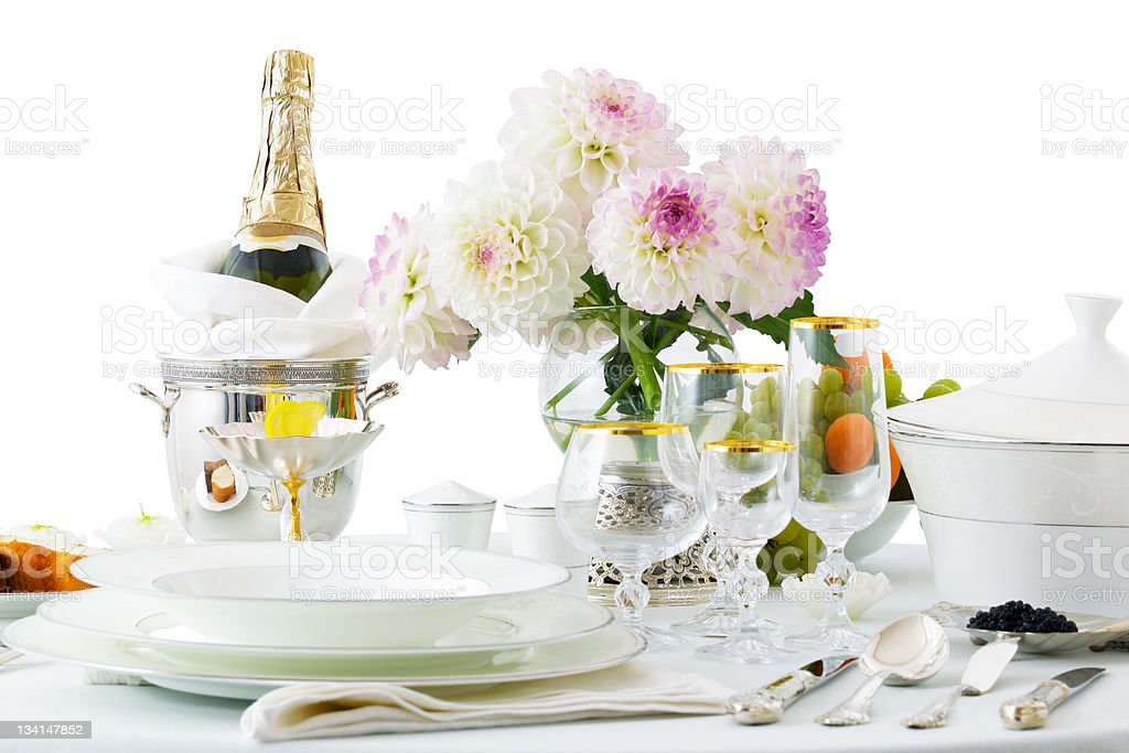 table with dishes and flowers royalty-free stock photo