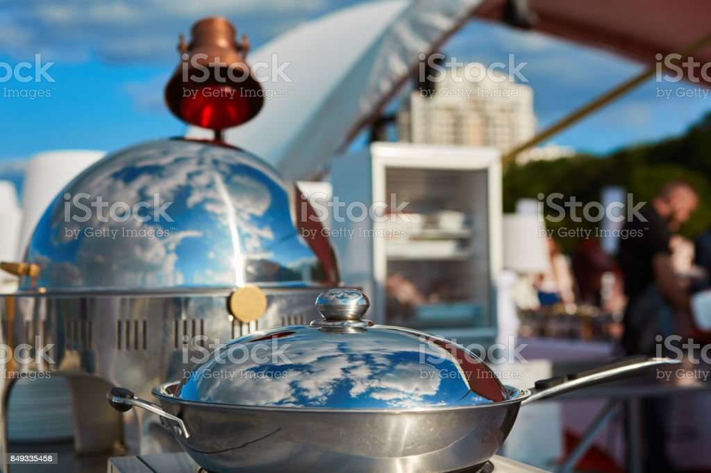 Table with dishware and marmites waiting for guests. stock photo