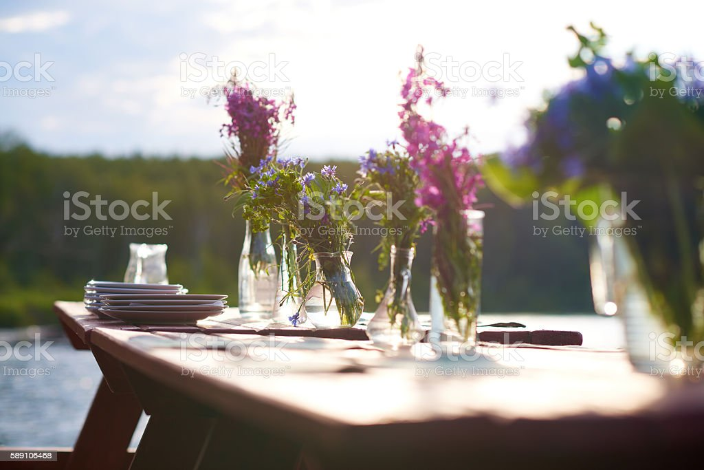 Table with flowers stock photo