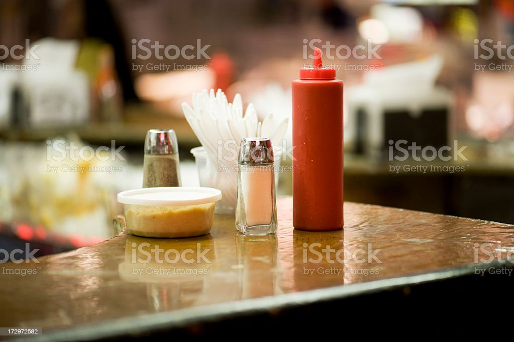 A table with four different condiments stock photo