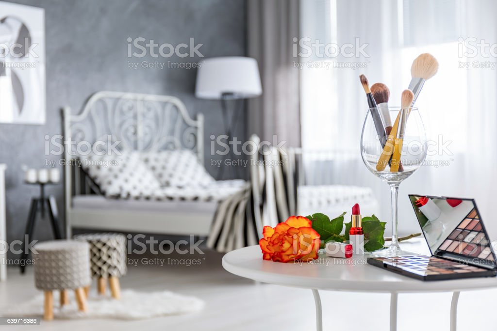 Table with makeup accessories stock photo