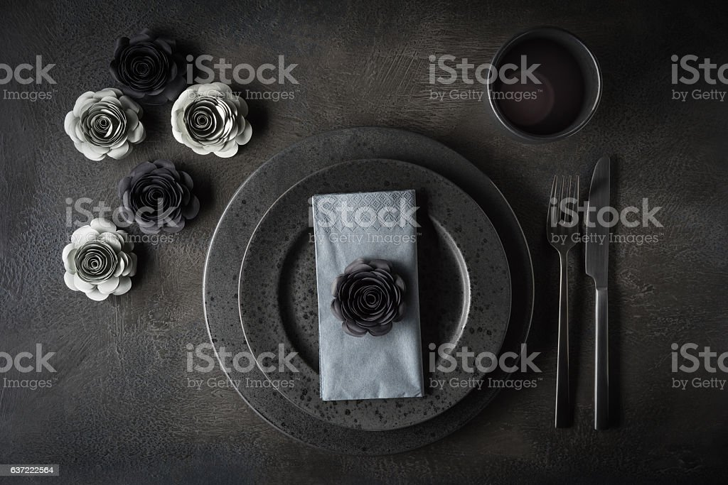 Table with paper flowers stock photo