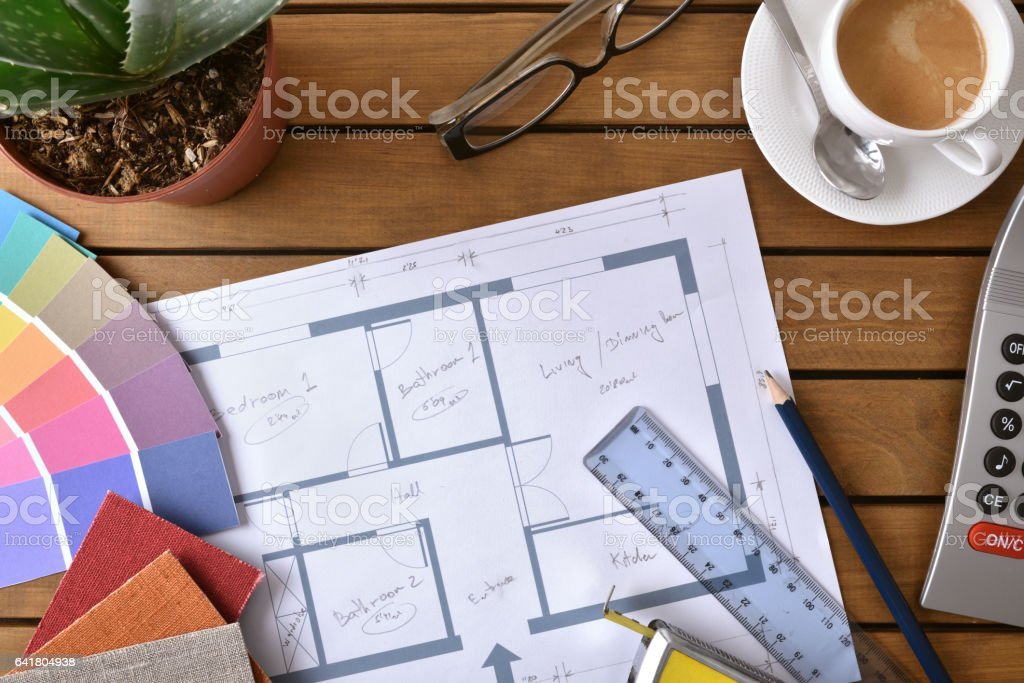 Table with plan tools and samples of a decorator top stock photo