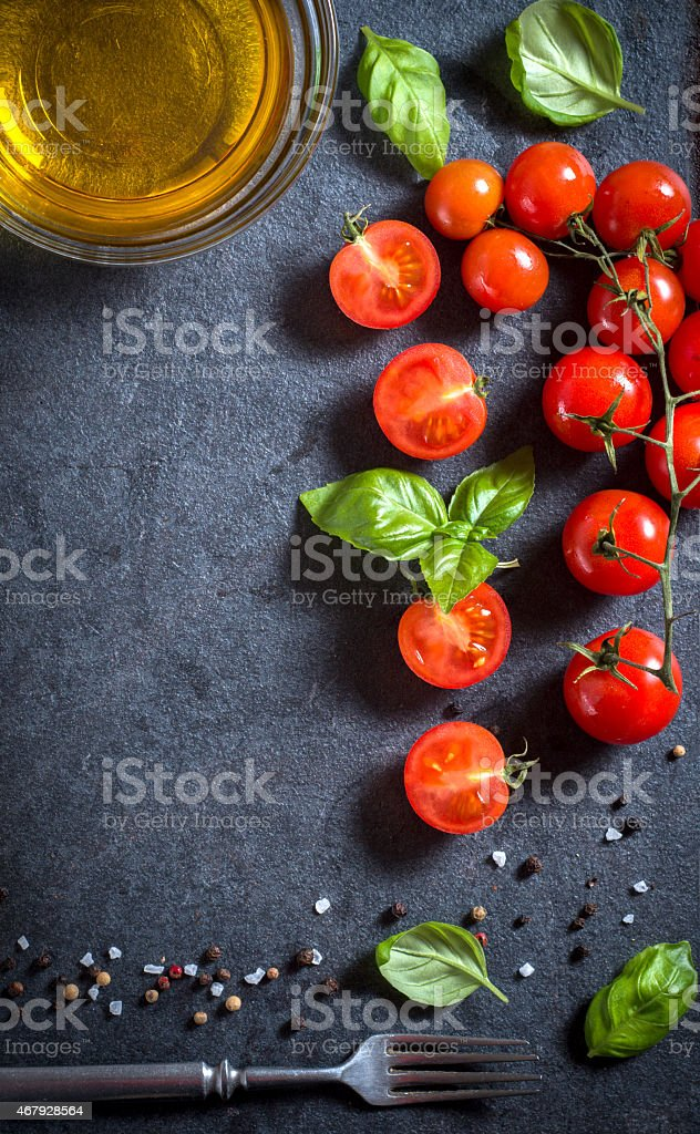 A table with tomatoes demonstrating the concept of cooking stock photo