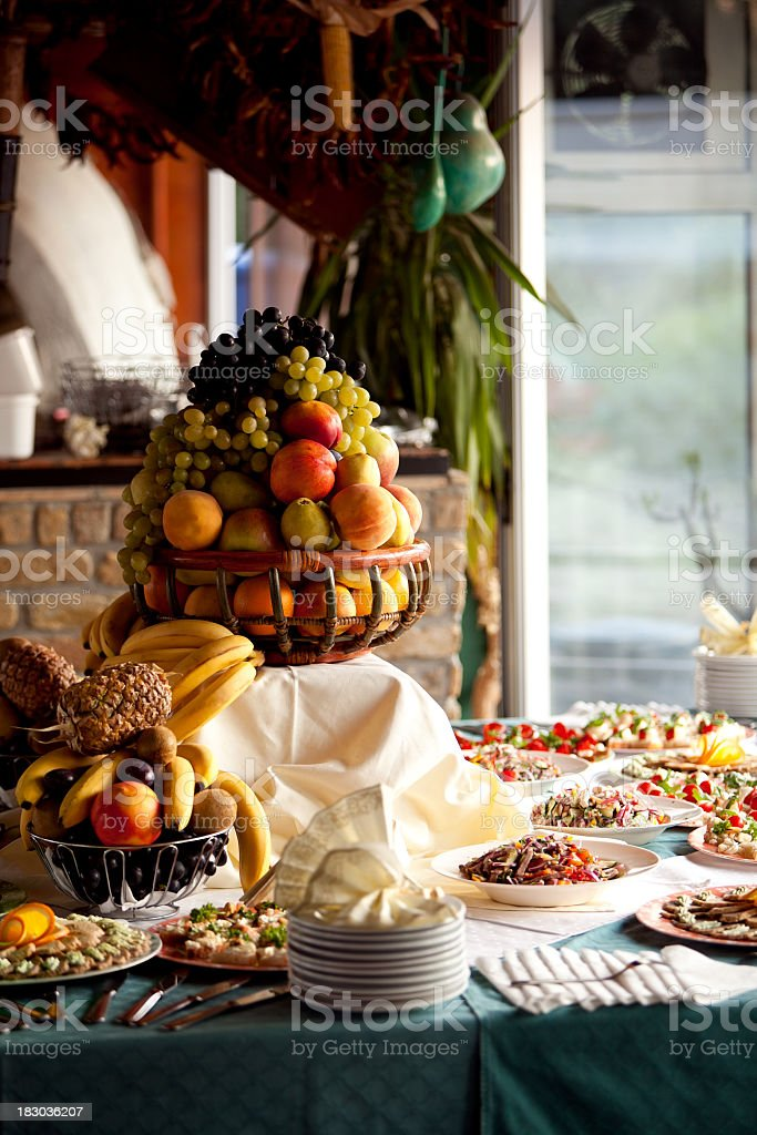 Table with various food and fruits for celebration banquet royalty-free stock photo