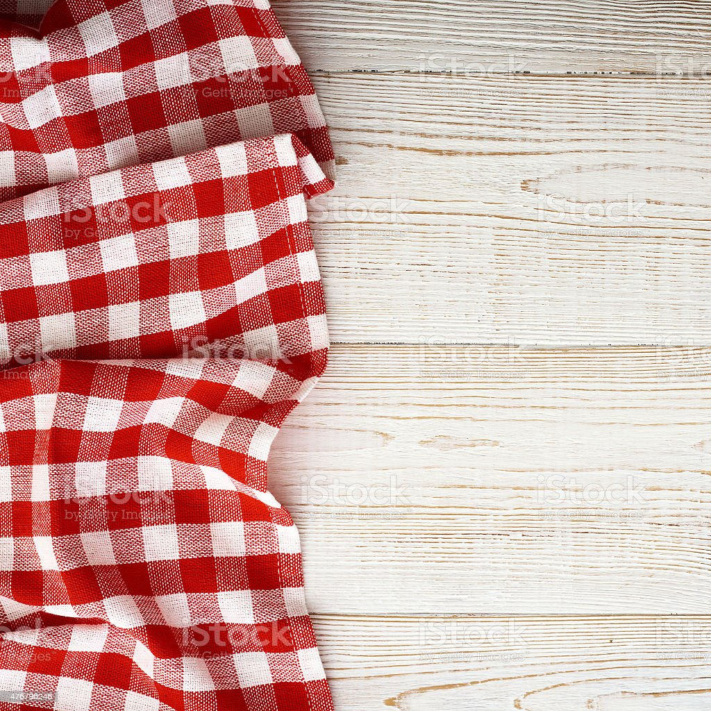 Tablecloth tartan on white wooden table. Flat mock up. Top stock photo