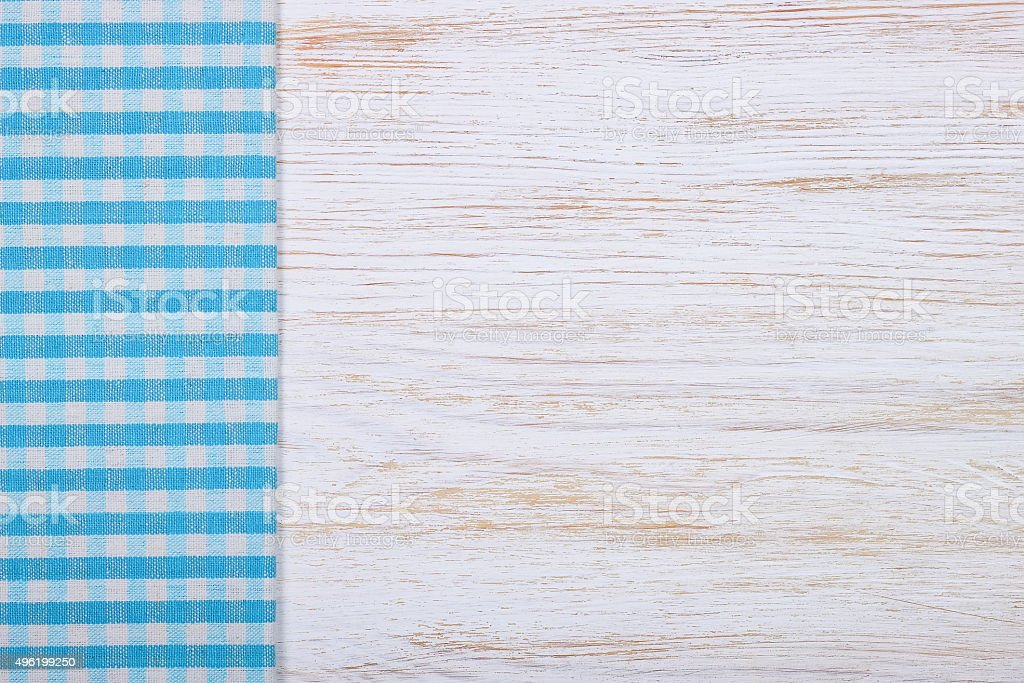 Tablecloth textile texture on wooden background stock photo