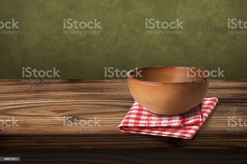 Tablecloths and soup bowl over wooden table royalty-free stock photo