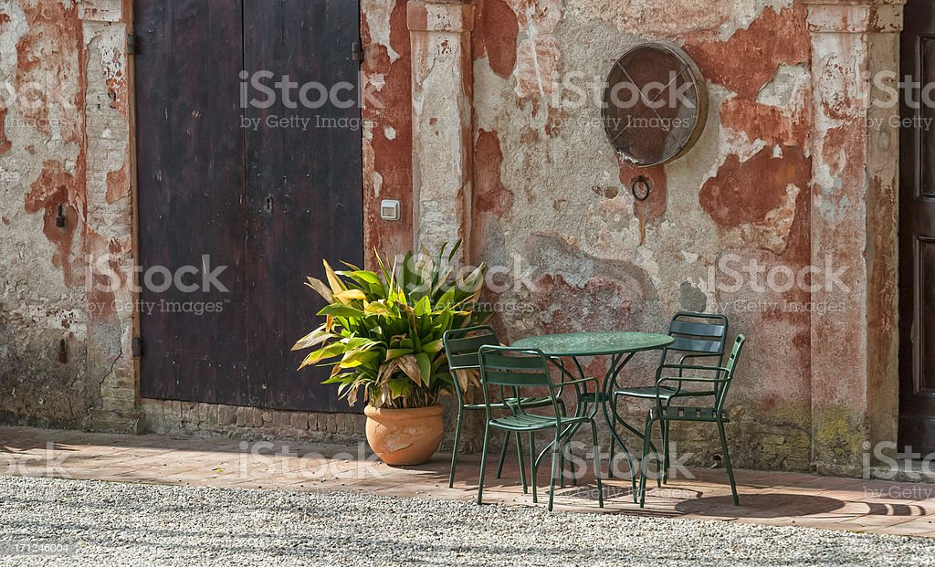 Tables and Chairs in a rustic farm, Tuscany royalty-free stock photo