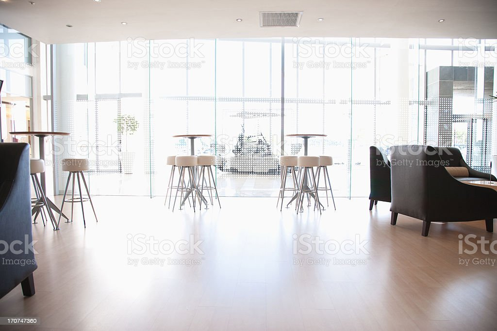 Tables and chairs in cafeteria stock photo